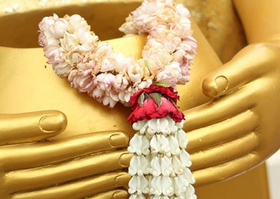 Flower offering for Buddha statue